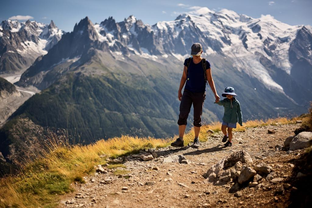 Jen and her daughter hiking through the mountains.