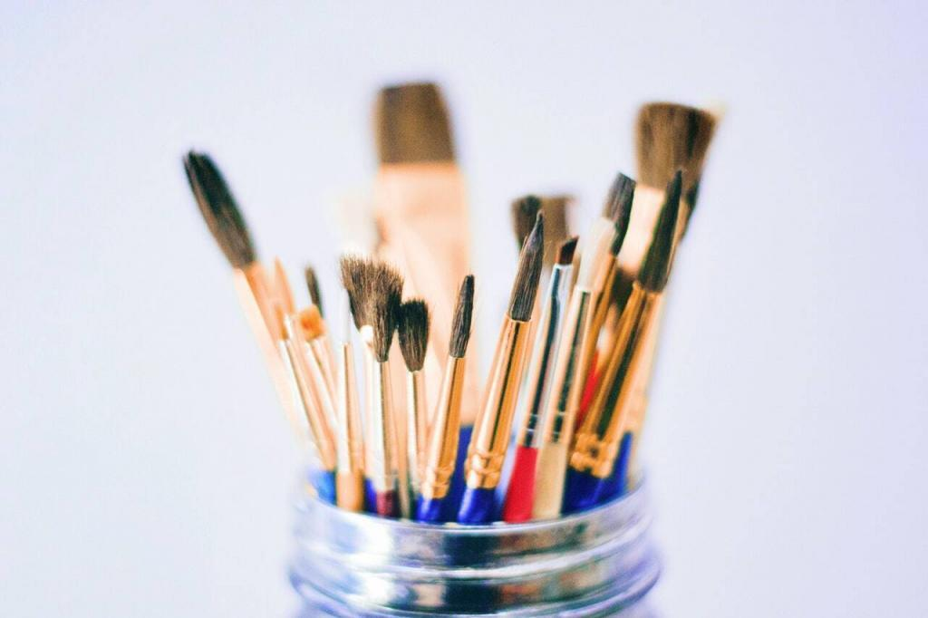 shallow-photography-of-brushes-on-jar-1084406